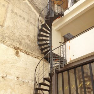 Double secured spiral staircase